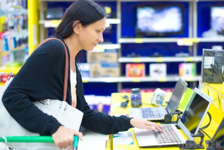 woman in store looking at computer